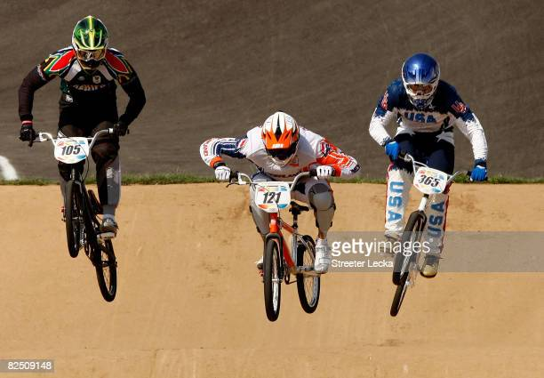 Sifiso Nhlapo of South Africa, Raymon van der Biezen of the Netherlands and Mike Day of the United States compete in the Men's BMX semifinal run held...