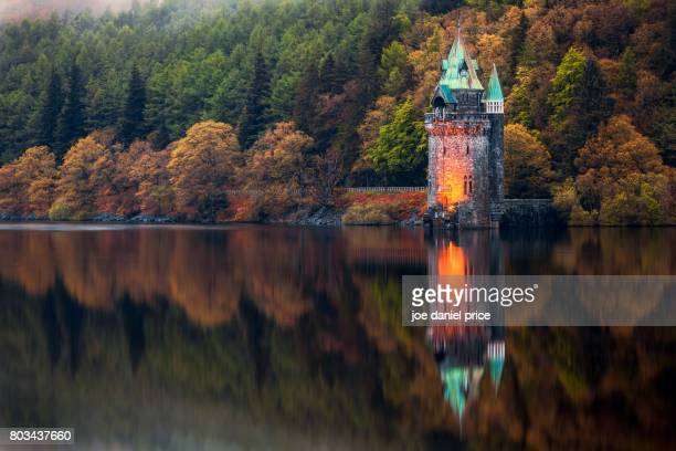 sifting tower reflection, lake vyrnwy, powys, north wales - lake vyrnwy stock pictures, royalty-free photos & images