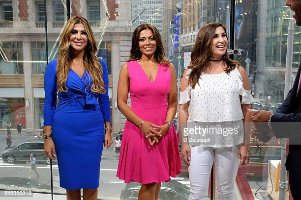 Siggy Flicker Dolores Catania and Jacqueline Laurita visit Extra at their New York studios at HM in Times Square on July 7 2016 in New York City