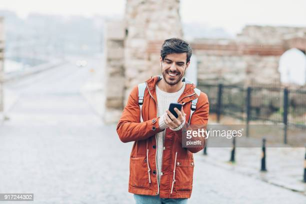 sightseeing and texting in the rain - history stock pictures, royalty-free photos & images