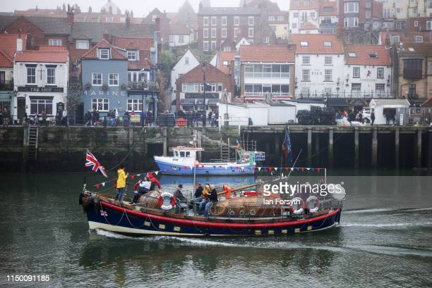 A sightseeing boat for tourists heads back from a trip out to sea as sea fog shrouds Whitby Harbour on May 18 2019 in Whitby England Heavy fog and...
