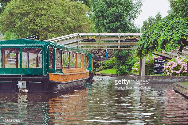 Sightseeing boat in the idyllic Village of Giethoorn, also knows as Venice of the Netherlands