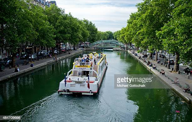 A Sightseeing Boat on Canal Saint Martin on July 31 2015 in Paris Frankreich