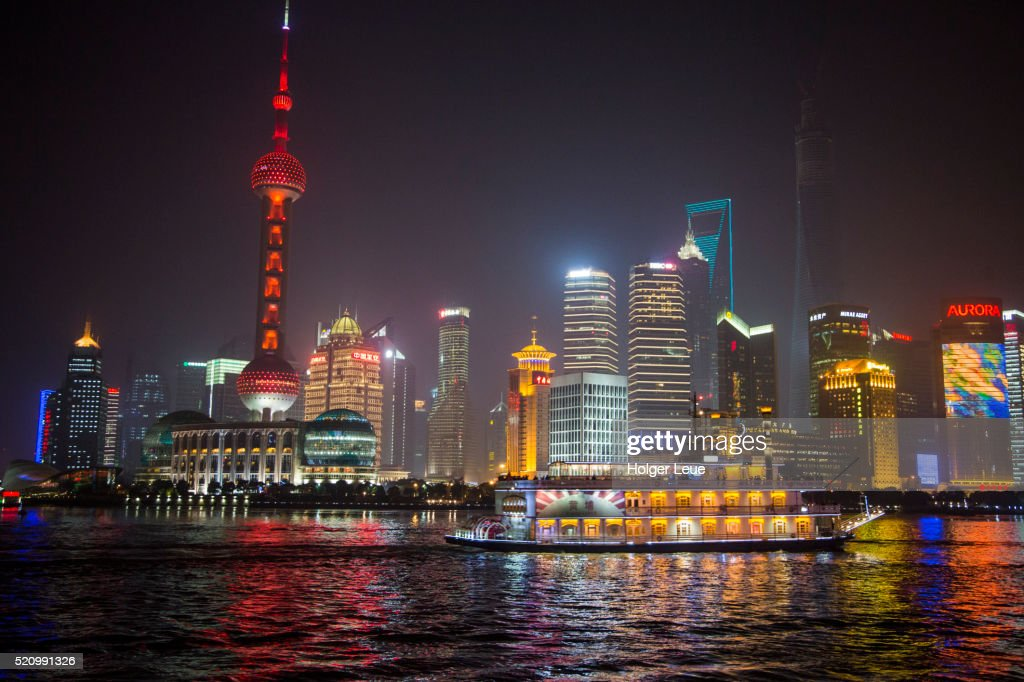 Sightseeing Boat On Huangpu River With Oriental Pearl Tower And
