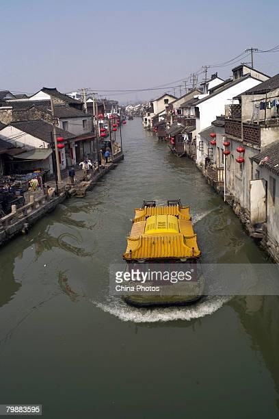 A sightseeing boat sails on a canal at the Shantang Street at the old urban area of Suzhou on February 20 2008 in Suzhou of Jiangsu Province China...