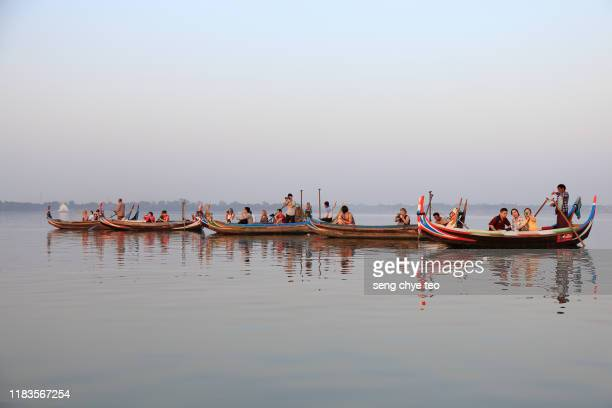 sightseeing boat seen at u bein bridge - teak wood material stock pictures, royalty-free photos & images