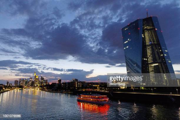 Sightseeing boat travels on the River Main past the European Central Bank skyscraper headquarters, right, at dusk in Frankfurt, Germany, on Tuesday,...