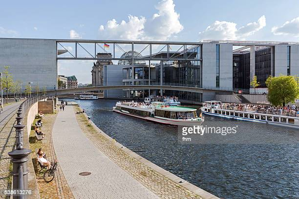 Sightseeing boats in government district on Spree river in Berlin/ Germany