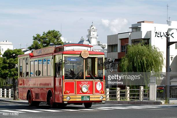 A sightseeing bus drives along a road in Matsue Shimane Prefecture on Tuesday Sept 9 2014 In Matsue Japanese Tennis Player Kei Nishikori's home town...