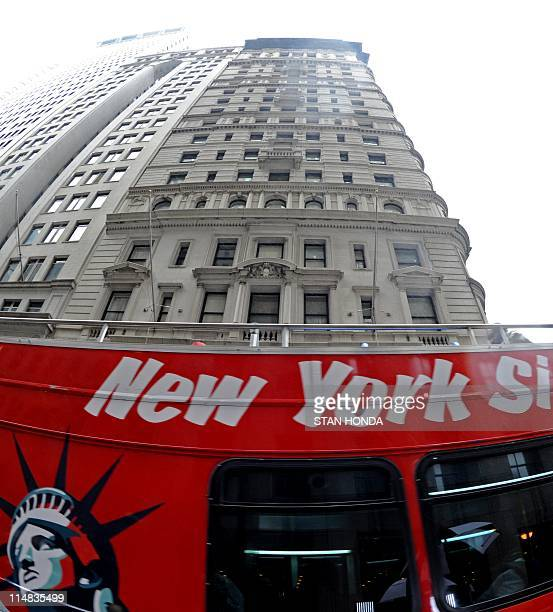 A sightseeing bus drives past the building where former IMF head Dominique StraussKahn is being held under house arrest after posting bail in New...