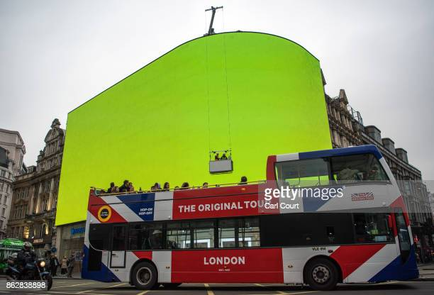 A sightseeing bus passes the Piccadilly Circus billboard as it displays a test screen on October 18 2017 in London England After nine months of works...
