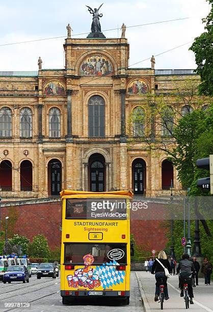Sightseeing bus with tourists on a trip in front of the Maximilianeum. On May 09, 2010 in Munich, Germany.