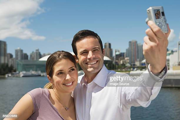 sightseeing couple in vancouver - traditionally canadian stock pictures, royalty-free photos & images