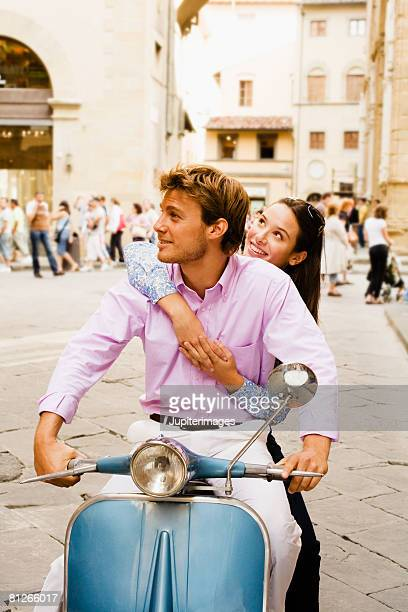 Sightseeing couple on scooter