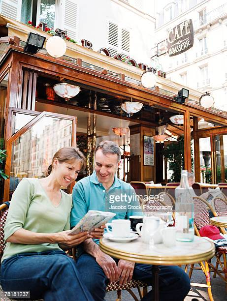 Sightseeing couple sitting in a cafe