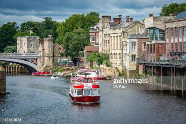 Sightseeing cruise takes tourists along the River Ouse through the historic city of York Yorkshire United Kingdom