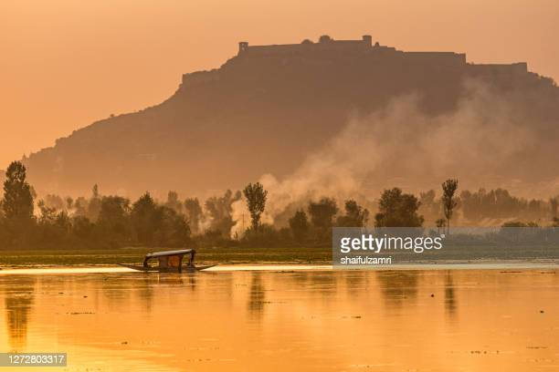 sightseeing over dal lake using a shikara - a type of traditional wooden boat. - shaifulzamri stock pictures, royalty-free photos & images