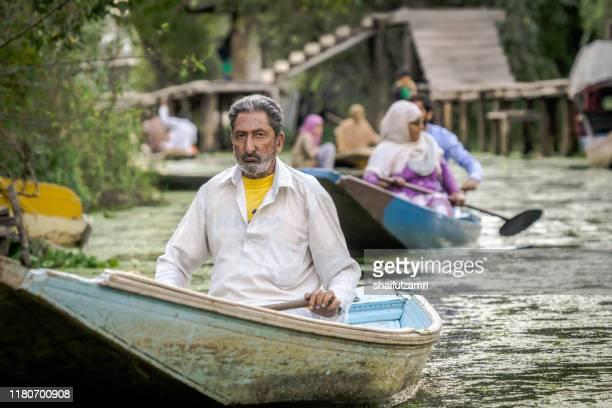 sightseeing over dal lake using a shikara at kashmir, india. - shaifulzamri stock pictures, royalty-free photos & images