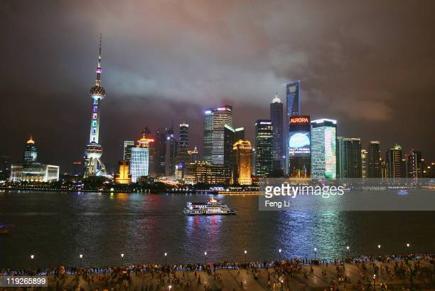 A sightseeing ship on the Huangpu River against the night skyline of Pudongs Lujiazui Financial District prior to the start of the 14th FINA World...
