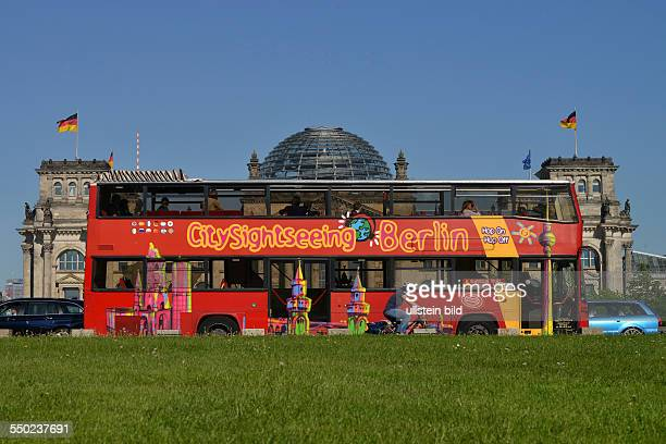 Sightseeing tour by bus in Berlin next to the German parliament