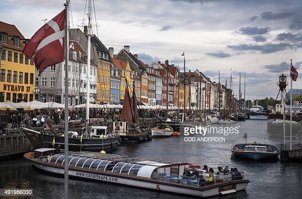 A sightseeing vessel is seen at Nyhavn canal in Copenhagen on October 9 2015 Hosting historical wooden ships the 17thcentury waterfront canal and...