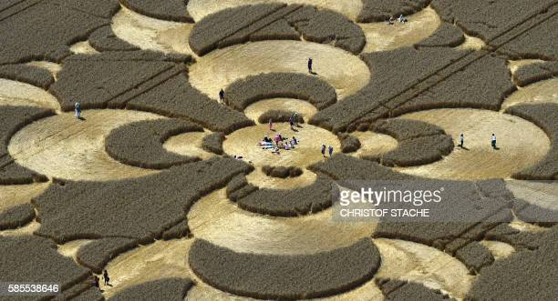 TOPSHOT Sightseers visit an incorporated oversized crop circle in a cornfield not far from the small community of Mammendorf near Munich southern...