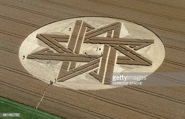 Sightseers visit an incorporated oversized star in a cornfield not far from the small community Biburg near Munich, southern Germany, pictured on...