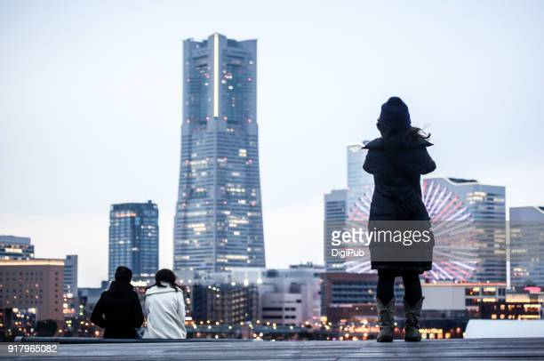 Sightseers watching Yokohama Minatomirai on the roof of Onsanbashi