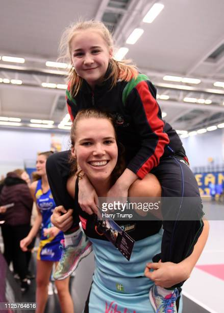 Sigi Burger of Surrey Storm celebrates with a young fan after the Vitality Netball Superleague match between Team Bath and Surrey Storm at the...
