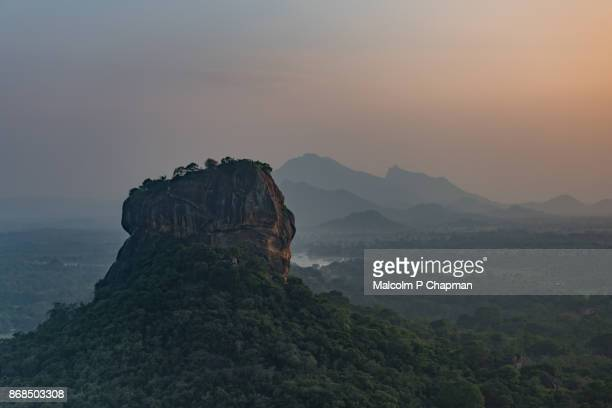 sigiriya lion rock fortress, sri lanka at sunset - sigiriya stock photos and pictures