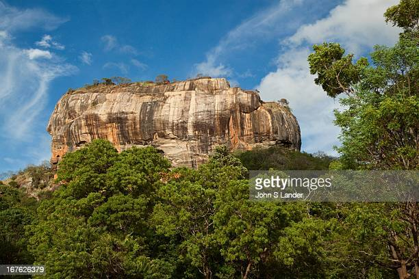 Sigiriya or Lion's rock is an ancient rock fortress and palace ruin surrounded by the remains of an extensive network of gardens reservoirs and other...