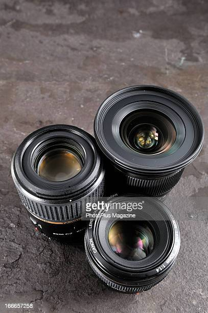 Sigma 20mm f/18 EX DG Canon EF 50mm f/14 and Tamron SP AF 60mm f/2 Di II Macro camera lenses photographed during a studio shoot for PhotoPlus...