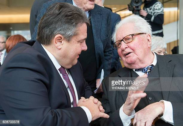 Sigmar Gabriel chairman of the German Social Democratic Party SPD and German Energy and Economy Minister talks with the party's former chairman...