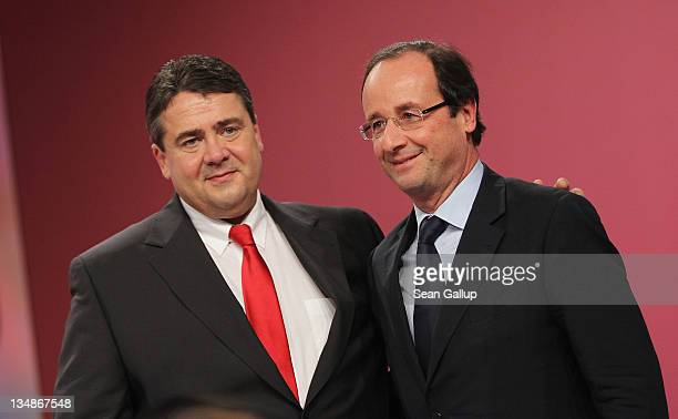 Sigmar Gabriel Chairman of the German Social Democrats and Francois Hollande French presidential candidate of the French Socialist Party prepare to...