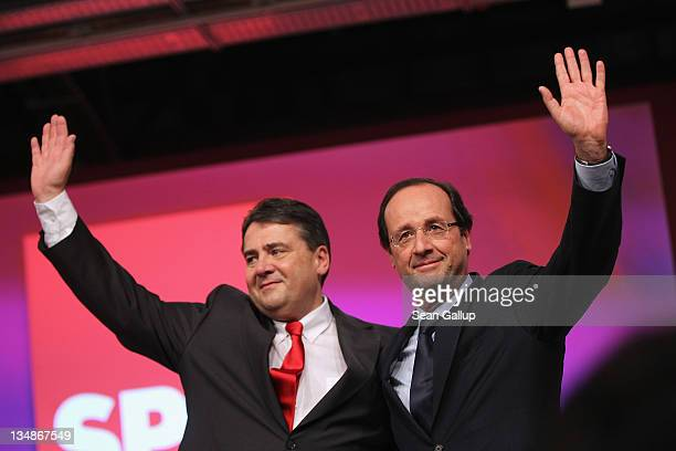 Sigmar Gabriel , Chairman of the German Social Democrats , and Francois Hollande, French presidential candidate of the French Socialist Party greet...