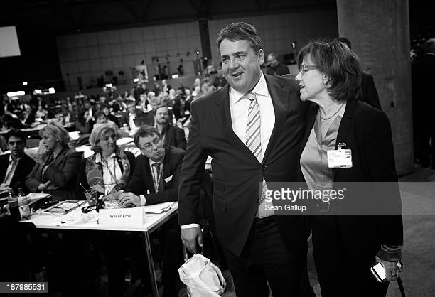 Sigmar Gabriel, Chairman of the German Social Democrats , chats with colleague Margit Conrad at the SPD federal party convention on November 14, 2013...