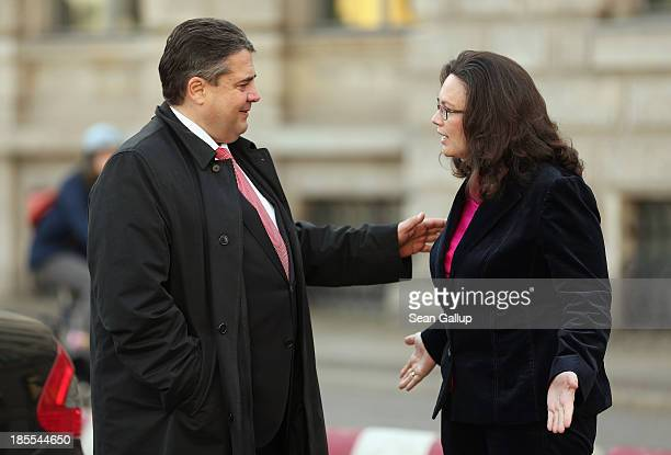 Sigmar Gabriel Chairman of the German Social Democrats chats with SPD General Secretary Andrea Nahles after a religious service at St Hedwig...