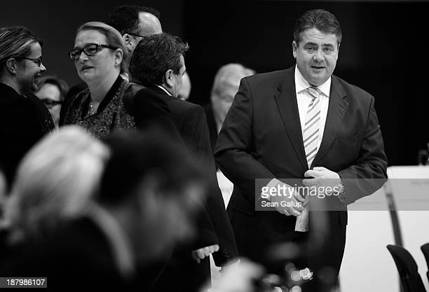Sigmar Gabriel , Chairman of the German Social Democrats , looks on after a spokeswoman announced that 83.7% of delegates voted for his re-election...
