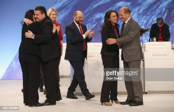 Sigmar Gabriel German Vice Chancellor and Chairman of the German Social Democrats embraces outgoing SPD General Secretary Andrea Nahles as Olaf...