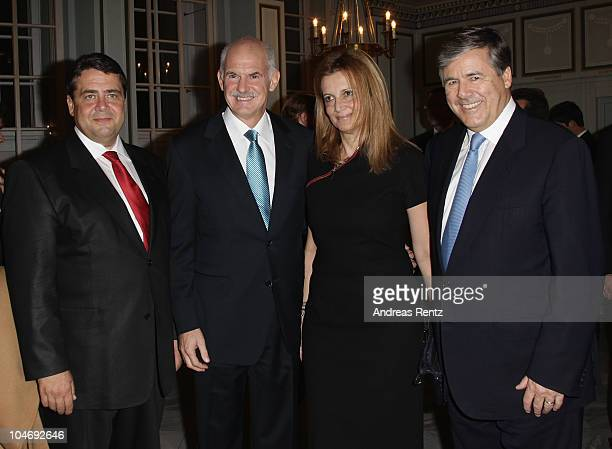 Sigmar Gabriel Greek Prime Minister Giorgos Papandreou with his wife Ada and Josef Ackermann attend the Quadriga awards at the Konzerthaus on...