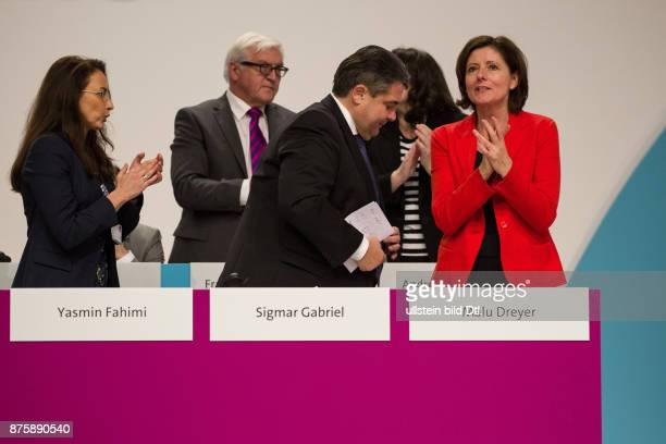 Sigmar Gabriel has been reelected as Chairman of the SPD on the federal party in Berlin on December 11 2015 From left Secretary General Yasmin Fahimi...