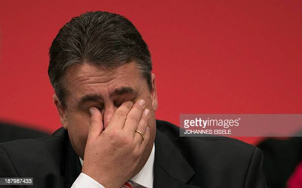 Sigmar Gabriel leader of the Social Democrat party wipes his eyes during the German Social Democrats party congress on November 14 2013 in Leipzig...
