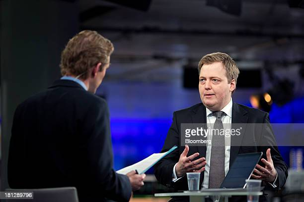 Sigmundur Gunnlaugsson Iceland's prime minister right gestures during a Bloomberg Television interview in London UK on Friday Sept 20 2013 Iceland's...