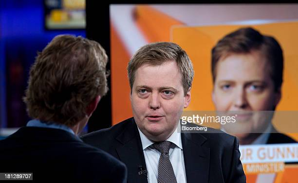 Sigmundur Gunnlaugsson Iceland's prime minister right speaks during a Bloomberg Television interview in London UK on Friday Sept 20 2013 Iceland's...