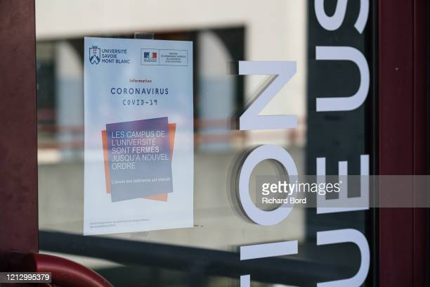 Sign about the Coronavirus is seen on the closed front door of the Annecy-Le-Vieux University Campus on March 17, 2020 in Annecy, France. Coronavirus...