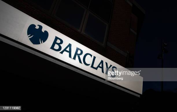 Sign above the entrance to a Barclays Bank Plc bank branch in Woking, U.K., on Friday, Feb. 12, 2021. The U.K. Economy grew at double the pace...