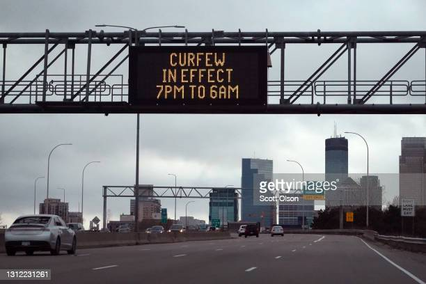 Sign above the interstate warns residents and visitors of a curfew put in place in an attempt to curtail violence on April 12, 2021 in Minneapolis,...