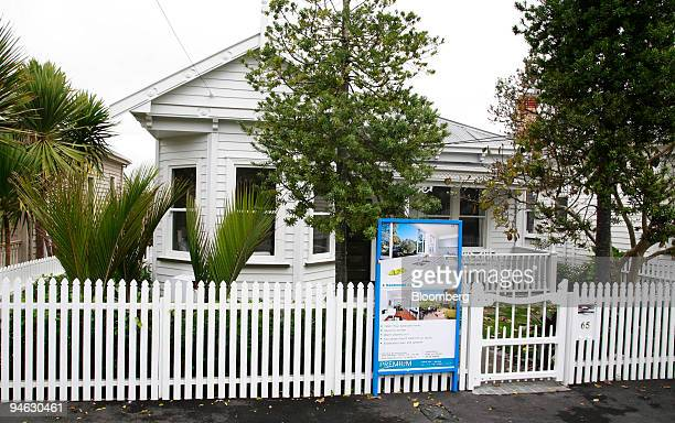 A sign advertises a home for sale in Auckland New Zealand on Tuesday June 12 2007 New Zealand house prices rose at the fastest pace in 11 months in...