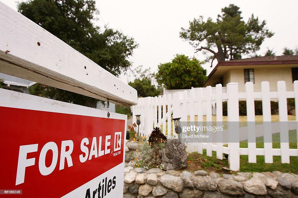 March Existing Home Sales Drop Three Percent : News Photo