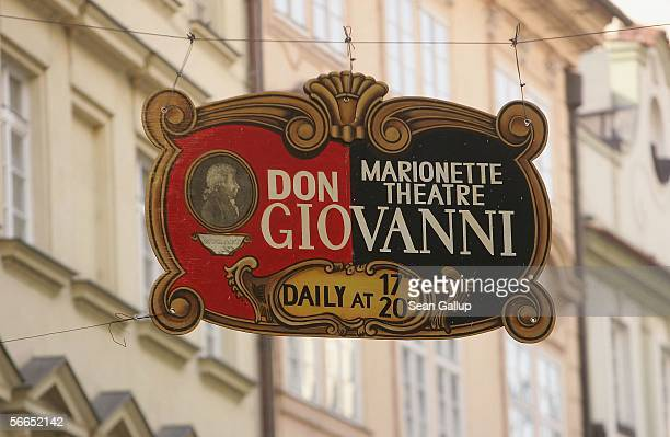 A sign advertises a marionette theatre's performance of Wolfgang Amadeus Mozart's 'Don Giovanni' opera January 23 2006 in central Prague Czech...